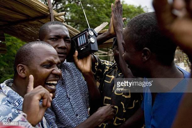 Sympathizers of Kenya's opposition leader Raila Odinga celebrate on the streets of Kisumu as they hear a radio transmission saying that Odinga had...