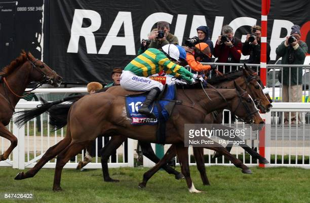 Synchronised ridden by Tony McCoy go on to win the Betfred Cheltenham Gold Cup Steeple Chase during day four of the 2012 Cheltenham Fesitval at...