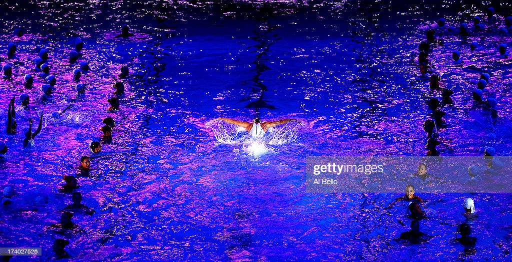 Synchronised swimmers perform during the Opening Ceremony of the 15th FINA World Championships at Palau Sant Jordi on July 19, 2013 in Barcelona, Spain.