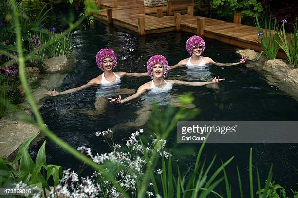 Synchronised swimmers perform in the 'M and G Garden 2015 The Retreat' show garden designed by Jo Thompson and sponsored by M and G Investments on...