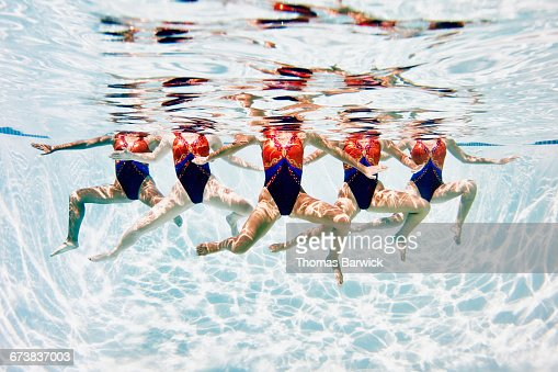 Synchronized swim team treading water together
