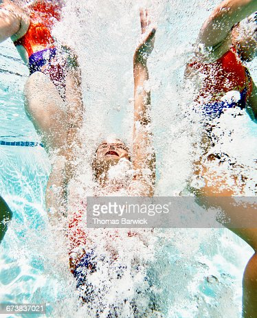 Synchronized swimmer underwater after lift