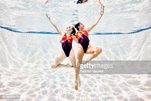 Synchronized swimmers performing routine