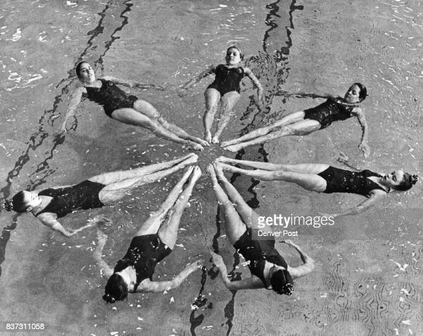 Synchronized Swimming is more than 'pretty movements' Performing water ballet pattern clockwise from the top are Lori Stover Lee Brock Mary Ann...
