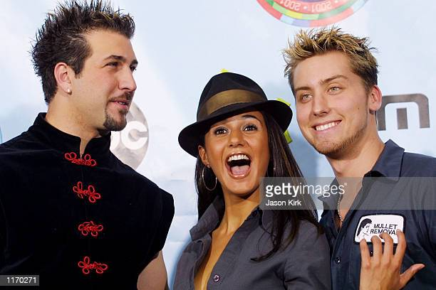 N'sYNC's Joey Fatone and Lance Bass share a laugh with actress Emmanuelle Chriqui backstage at the 2001 Radio Music Awards at the Aladdin Resort and...