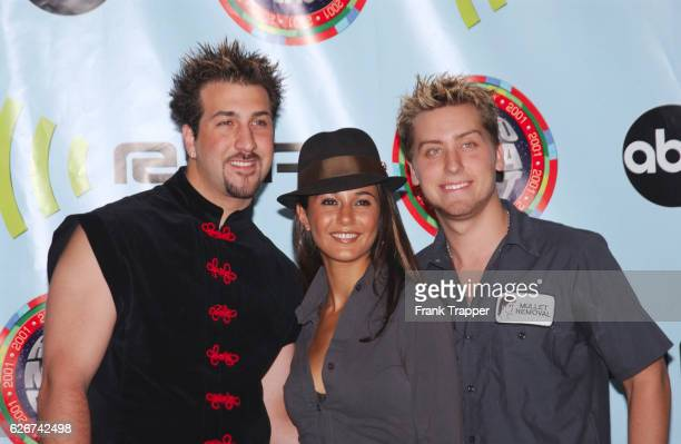 N'Sync's Joey Fatone and Lance Bass with Emmanuelle Chriqui backstage at the 2001 Radio Music Awards held at the Aladdin Resort and Casino