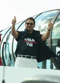 Syndicate head of Oracle Larry Ellison celebrates his team's win after race four of the Louis Vuitton Cup Final between Alinghi of Switzerland and...