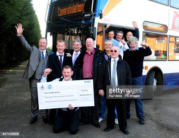 A syndicate of bus drivers from Corby Northamptonshire celebrate after winning pound38 million in the EuroMillions Chris Smith with cheque and John...
