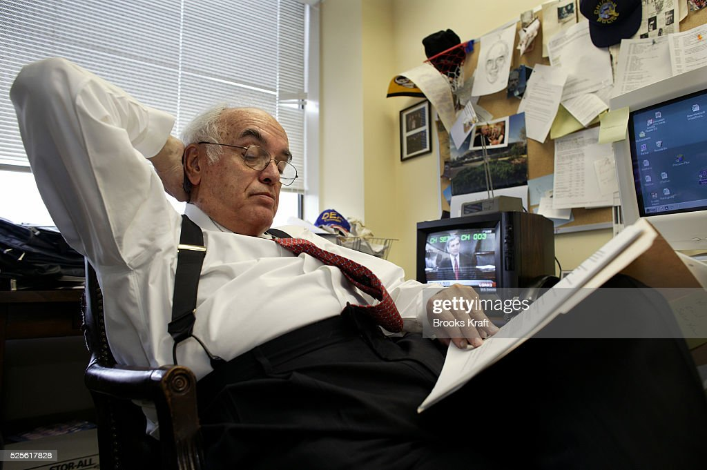 Syndicated columnist Robert Novak reads in his Washington DC office Novak also a conservative commentator on CNN disclosed in an article on July 14...