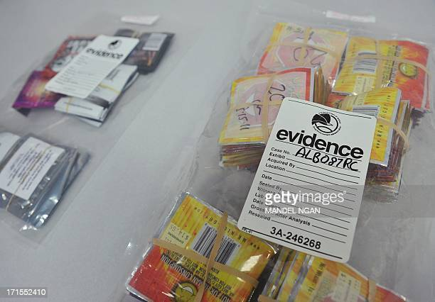 Synthetic drugs in evidence bags are seen during a press conference at DEA Headquarters on June 26 2013 in Arlington Virginia The DEA and its law...