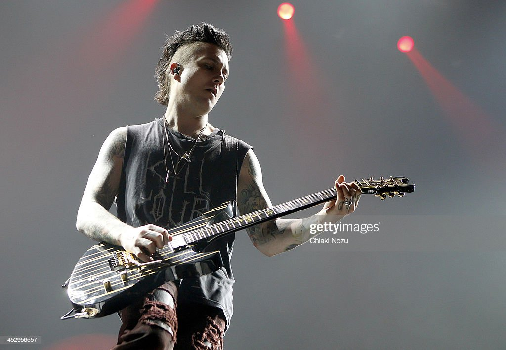 Synyster Gates of Avenged Sevenfold performs at Wembley Arena on December 1 2013 in London England