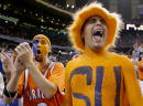 Syracuse fans Chad Davis of Fogelsville Pennsylvania left and Nick Friedell of Orlando Florida cheer on their team during the championship game of...
