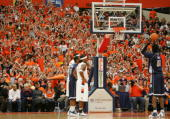 Syracuse fans distract Center Roy Hibbert of the Georgetown Hoyas looks on as he shoots two foul shots during the game between the Georgetown...
