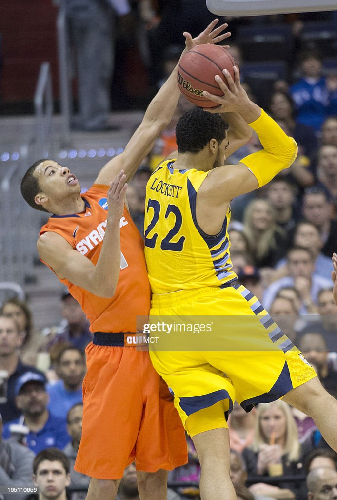 Syracuse guard Michael Carter-Williams (1) defends against Marquette guard Trent Lockett (22) in the first half of the NCAA Tournament East Regional final at the Verizon Center in Washington, D.C., Saturday, March 30, 2013.