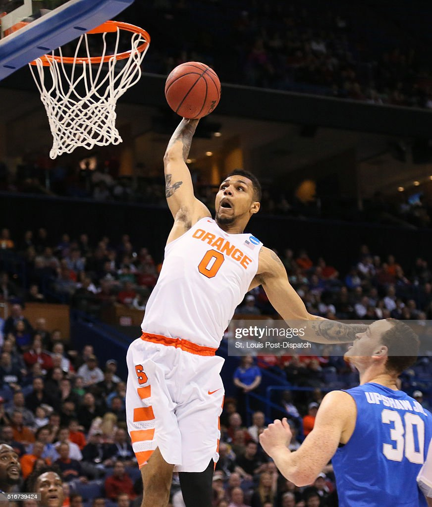 Syracuse guard Michael Gbinije dunks over Middle Tennessee forward Reggie Upshaw Jr during the first half on Sunday March 20 at the Scottrade Center...
