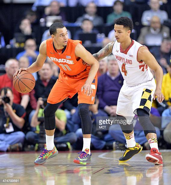 Syracuse guard Tyler Ennis dribbles around Maryland guard Seth Allen in the first half as the Syracuse Orange beat the University of Maryland 5755 at...