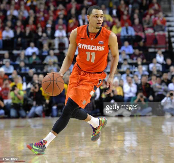 Syracuse guard Tyler Ennis looks for an open teammate in the second half as the Syracuse Orange beat the University of Maryland 5755 at Comcast...