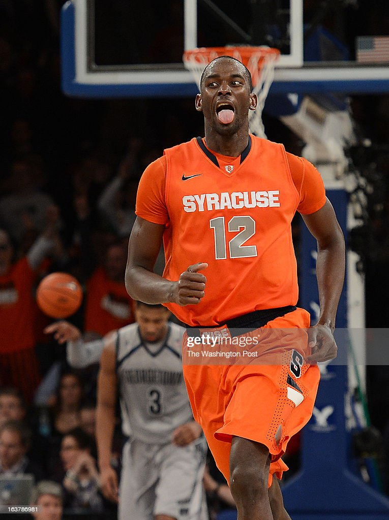Syracuse Orange center Baye Keita (12) reacts after making a basket during overtime of a Semifinal Round game of the Big East Championship at Madison Square Garden on Friday, March 15, 2013. The Georgetown Hoyas lost to the Syracuse Orange 58-55 in overtime.