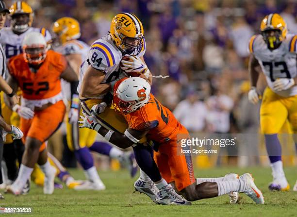 Syracuse Orange defensive back Jordan Martin tackles LSU Tigers tight end Foster Moreau during a college football game between the LSU Tigers and the...