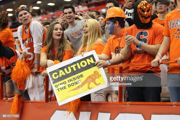 Syracuse Orange fans hold sign during a college football game between Clemson Tigers and Syracuse Orange on October 13 2017 at the Carrier Dome in...
