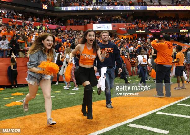 Syracuse Orange fans rush to midfield of the Carrier Dome to celebrate the Orange's 2724 victory over ranked Clemson Tigers on October 13 2017 at the...