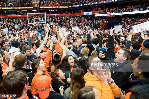 Syracuse Orange fans storm the court following the team's upset win over Virginia Cavaliers on February 4 2017 at The Carrier Dome in Syracuse New...