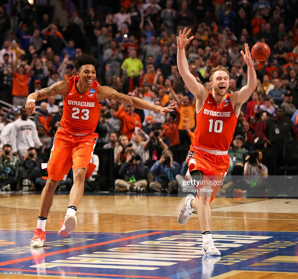 Syracuse Orange guard Malachi Richardson and Syracuse Orange guard Trevor Cooney celebrate at the end of their team's 6862 win over the Virginia...