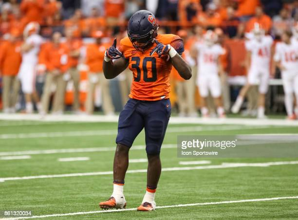 Syracuse Orange linebacker Parris Bennett dances at midfield after a defensive stop during a college football game between Clemson Tigers and...
