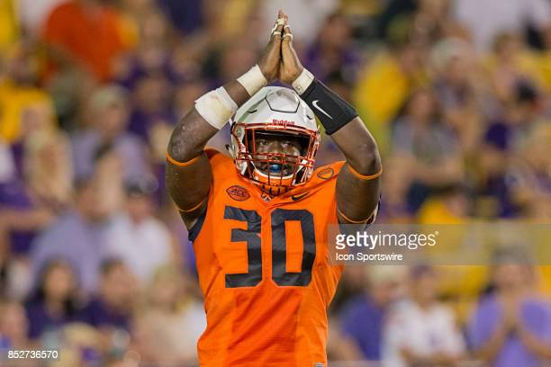 Syracuse Orange linebacker Parris Bennett shows a safety sign against LSU Tigers during a college football game between the LSU Tigers and the...