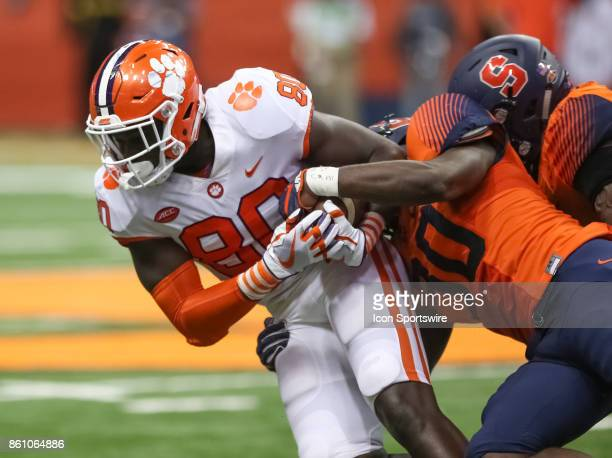 Syracuse Orange linebacker Parris Bennett tackles Clemson Tigers tight end Milan Richard during a college football game between Clemson Tigers and...