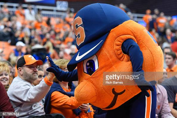 Syracuse Orange mascot Otto highfives a fan prior to the game against the North Florida Ospreys at the Carrier Dome on December 3 2016 in Syracuse...