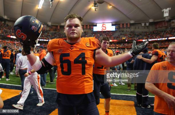 Syracuse Orange offensive lineman Colin Byrne celebrates the Orange's 2724 victory over ranked Clemson Tigers on October 13 2017 at the Carrier Dome...