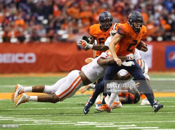 Syracuse Orange quarterback Eric Dungey is wrapped up by Clemson Tigers defensive end Austin Bryant during a college football game between Clemson...