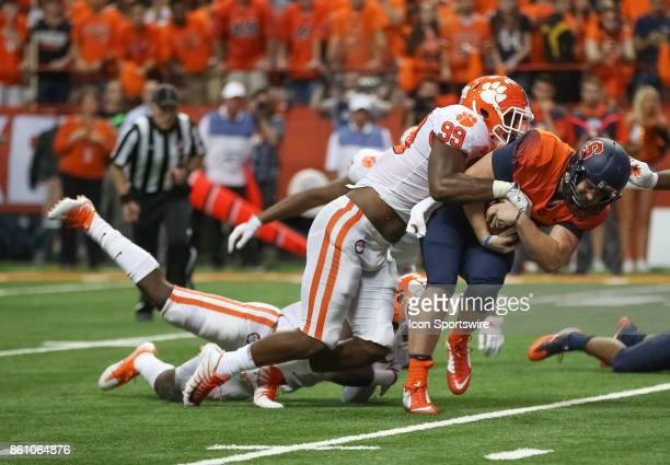 Syracuse Orange quarterback Zack Mahoney is sacked by Clemson Tigers defensive end Clelin Ferrell during a college football game between Clemson...
