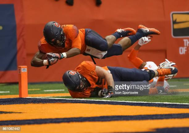 Syracuse Orange running back Dontae Strickland dives into the end zone for a touchdown during a college football game between Clemson Tigers and...