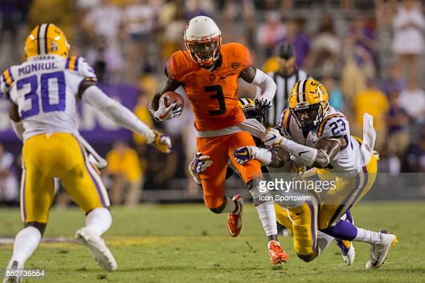 Syracuse Orange wide receiver Ervin Philips is tackled by LSU Tigers linebacker Corey Thompson during a college football game between the LSU Tigers...