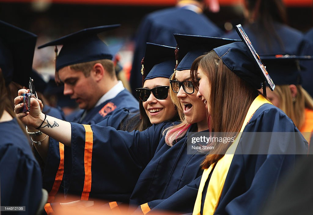 Syracuse University graduates take a picture together during the 2012 Syracuse University Commencement at Syracuse University on May 13 2012 at the...