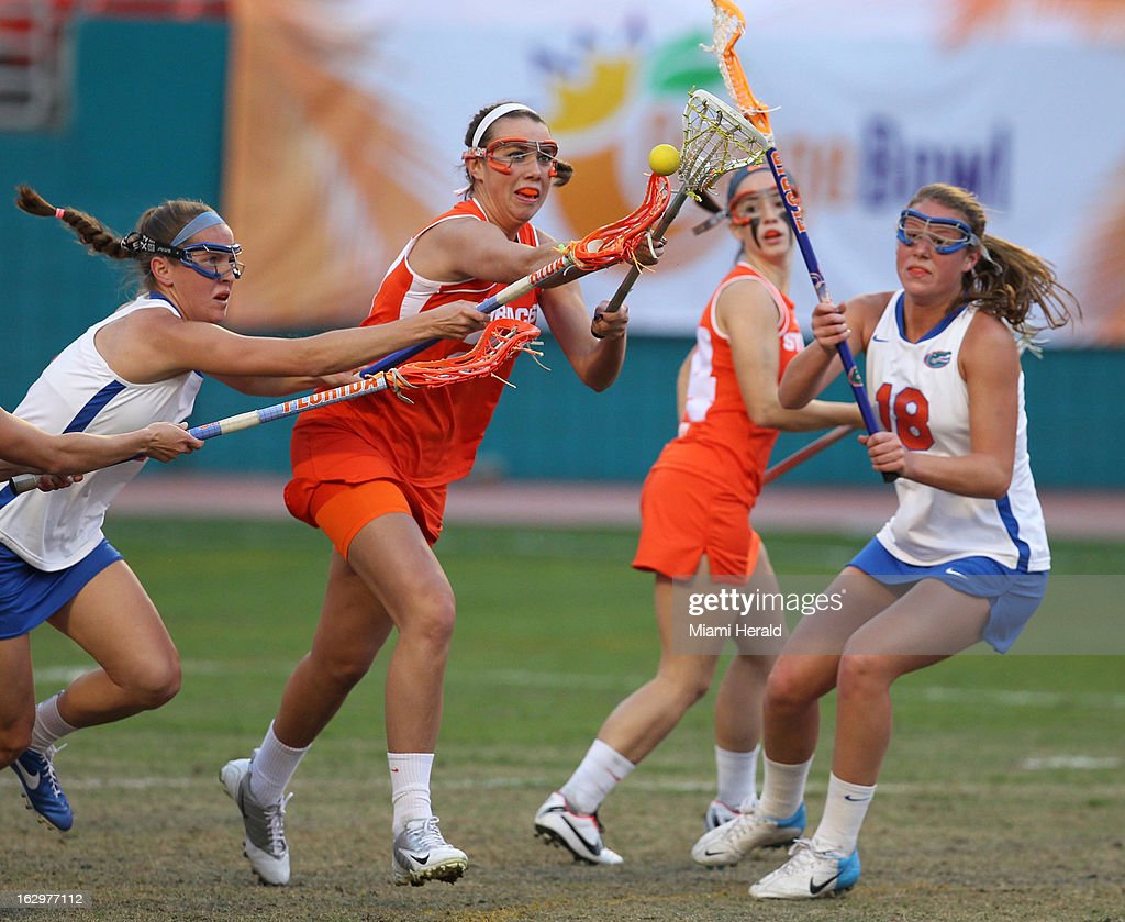 Syracuse's Kelly Cross, middle, works against Florida defenders during the Orange Bowl Lacrosse Classic at Sun Life Stadium in Miami Gardens, Florida, on Saturday, March 2, 2013.