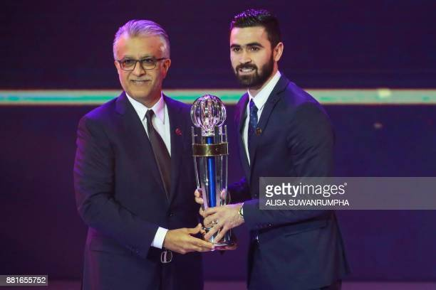 Syria and AlHilal player Omar Khrbin receives the Asian Football Confederation Men's Player of the Year award at the AFC Annual Awards in Bangkok on...