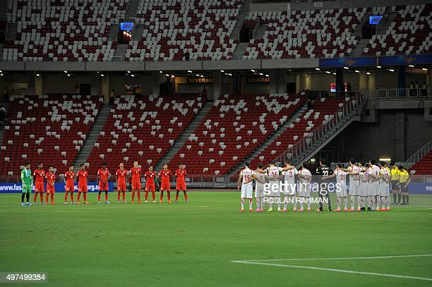 Syria and Singapore football players observe a 30 second silence in a tribute to Paris attacks before the start of their 2018 FIFA Group E World Cup...