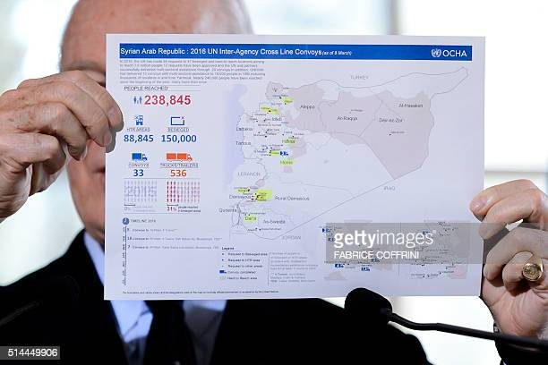 UN Syria envoy Staffan de Mistura displays a map showing the UN aid provided in Syria during a press briefing on the UN taskforces monitoring the...