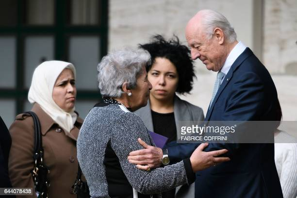 UN Syria envoy Staffan de Mistura speaks with a member of a group of Syrian who are holding a vigil in Geneva to urge parties in the intraSyrian...