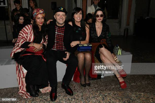 Syria Max Pezzali guest and Paola Iezzi attend the Au Jour Le Jour show during Milan Fashion Week Fall/Winter 2017/18 on February 26 2017 in Milan...