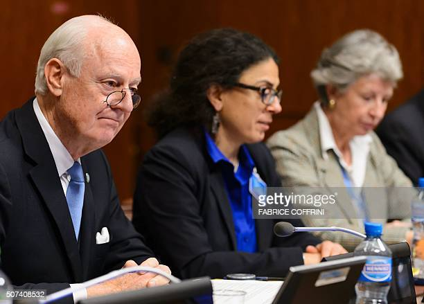Syria UN envoy Staffan de Mistura mets representatives of the Syrian regime at the opening of Syrian peace talks at the United Nations offices in...
