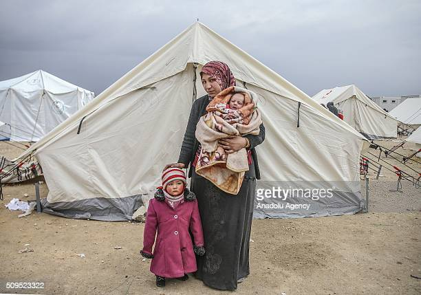 Syrian 2 year old baby Zehra and Eye Halip who fled bombing in Aleppo are seen with their mother Belkiz Halip at a tent city close to the Bab alSalam...