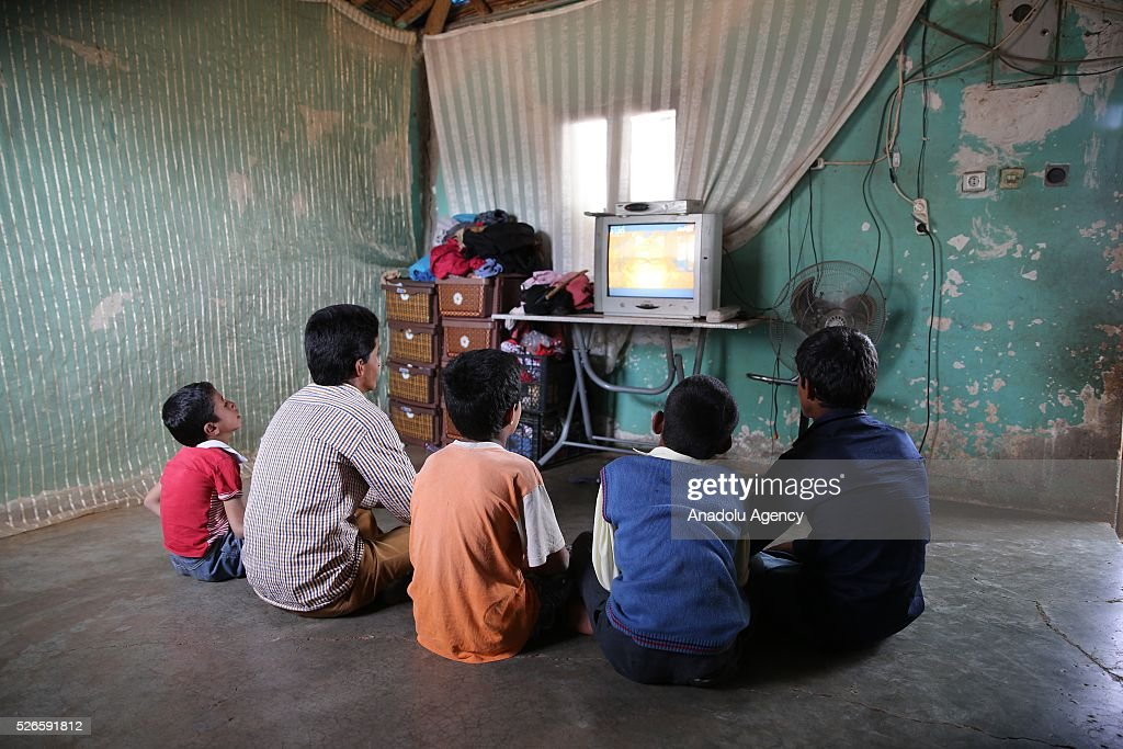 Syrian Abdulkadir, Kaddur ve Alhomed families' children with hearing loss which affect speech perception watch tv in Turkey's Reyhanli district after fleeing to Turkey from Syrian civil war on April 30, 2016. Syrians, who lost their relatives, try to start a new life in Hatay's Reyhanli district where they took shelter after they fled the airstrikes carried out by the Assad regime forces.