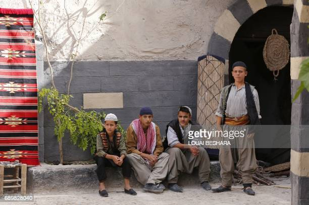 Syrian actors are seen on the filming set of television series 'Tawq alBanat' in the village of Yaafur some 20kilometres west of Damascus on May...