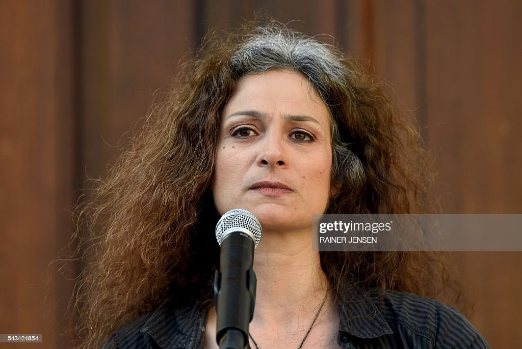 Syrian actress May Skaf speaks in front of the Gorki-Theater in Berlin on June 28, 2016 after the plans by German activists of the so-called 'Center for Political Beauty' were cancelled to fly in 100 refugees to Berlin-Tegel airport in a chartered airplane. / AFP / dpa / Rainer Jensen / Germany OUT