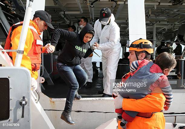 Syrian and Afghan refugees who tried to go to Greek Island Samos are seen on Turkish Coast Guard ship TCSG Umut after they were caught by TCSG Umut...