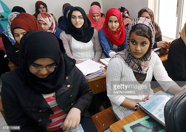 Syrian and Iraqi refugees attend a launching ceremony of a UN sponsored educational project at the AlAdala School in Arbil the capital of the...